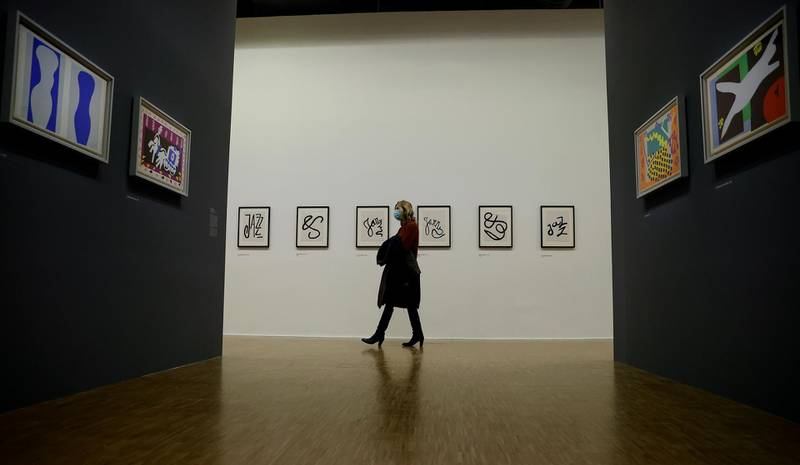 epa08759043 A visitor looks at works of art by French artist Henri Matisse, displayed as part of a retrospective exhibition entitled 'Matisse, like a novel' and held at he Pompidou center in Paris, France, 20 October 2020. The exhibition runs from 21 October to 22 February 2021.  EPA-EFE/IAN LANGSDON