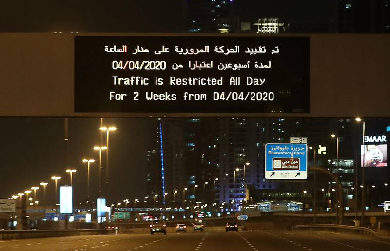 DUBAI, UNITED ARAB EMIRATES , April 05 – 2020 :- Traffic restriction message on Sheikh Zayed road in Dubai.  Dubai is conducting 24 hours sterilisation programme across all areas and communities in the Emirate and told residents to stay at home. UAE government told residents to wear face mask and gloves all the times outside the home. (Pawan Singh / The National) For News/Online/Instagram.