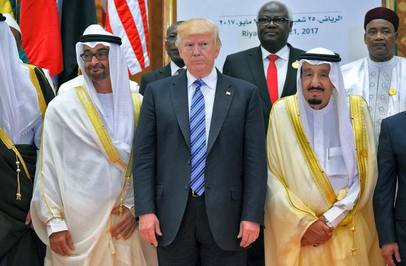 US President Donald Trump (C) and Saudi Arabia's King Salman bin Abdulaziz al-Saud (R) and Crown Prince of Abu Dhabi Mohammed bin Zayed Al Nahyan (L) pose for a group photo during the Arab Islamic American Summit at the King Abdulaziz Conference Center in Riyadh on May 21, 2017. (Photo by MANDEL NGAN / AFP)