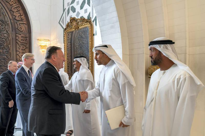 ABU DHABI, UNITED ARAB EMIRATES - September 19, 2019: HE Khaldoon Khalifa Al Mubarak, CEO and Managing Director Mubadala, Chairman of the Abu Dhabi Executive Affairs Authority and Abu Dhabi Executive Council Member (2nd R), greets Michael R Pompeo, Secretary of State of the United States of America (L), prior to a meeting the Sea Palace. Seen with HE Mohamed Mubarak Al Mazrouei, Undersecretary of the Crown Prince Court of Abu Dhabi (R).   ( Mohamed Al Hammadi / Ministry of Presidential Affairs ) ---