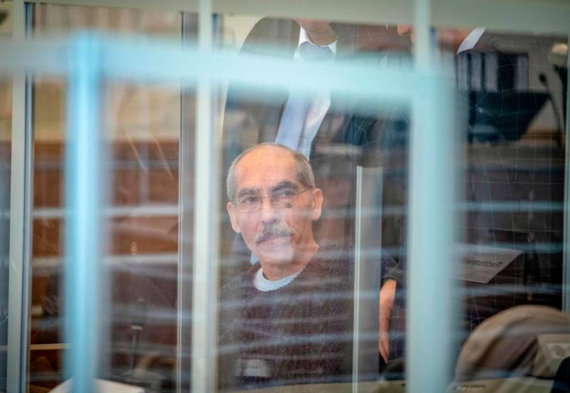 Syaian defendant Anwar Raslan, 57, arrives at court for an unprecedented trial on state-sponsored torture in Syria, on April 23, 2020 at court in Koblenz, western Germany.  Two alleged former Syrian intelligence officers go on trial in Germany on April 23, 2020 accused of crimes against humanity in the first court case worldwide over state-sponsored torture by Bashar al-Assad's regime. Prime suspect Anwar Raslan, an alleged former colonel in Syrian state security, stands accused of carrying out crimes against humanity while in charge of the Al-Khatib detention centre in Damascus between April 29, 2011 and September 7, 2012.  / AFP / POOL / Thomas Lohnes