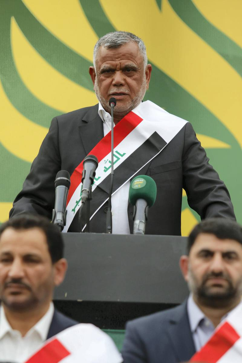 Hadi al-Ameri, head of the Badr organisation and leader of the mostly Shiite Hashed al-Shaabi paramilitary units, speaks during a campaign gathering in the city of Basra on April 21, 2018. / AFP PHOTO / HAIDAR MOHAMMED ALI