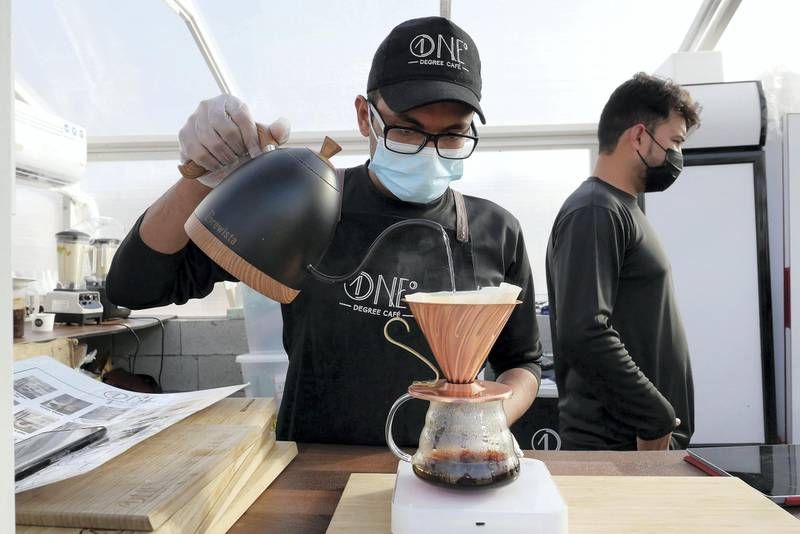 DUBAI, UNITED ARAB EMIRATES , March 1, 2021 – Staff preparing filter coffee at the One Degree Café in Margham area in Dubai. (Pawan Singh / The National) For Lifestyle/Instagram/Online. Story by Janice