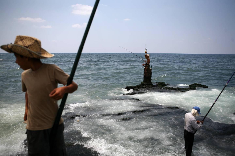 Beirut, Lebanon - July 13, 2008 - Men fish on the mediterranean sea. (Nicole Hill / The National) *** Local Caption ***  NH Shatila 13.jpgNH Shatila 13.jpg