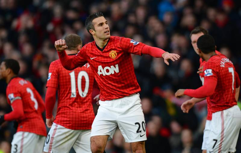 """Manchester United's Dutch forward Robin van Persie (2-R) celebrates after scoring the first goal during the English Premier League football match between Manchester United and Sunderland at Old Trafford in Manchester, north-west England on December 15, 2012. AFP PHOTO/ANDREW YATES  RESTRICTED TO EDITORIAL USE. No use with unauthorized audio, video, data, fixture lists, club/league logos or """"live"""" services. Online in-match use limited to 45 images, no video emulation. No use in betting, games or single club/league/player publications (Photo by ANDREW YATES / AFP)"""