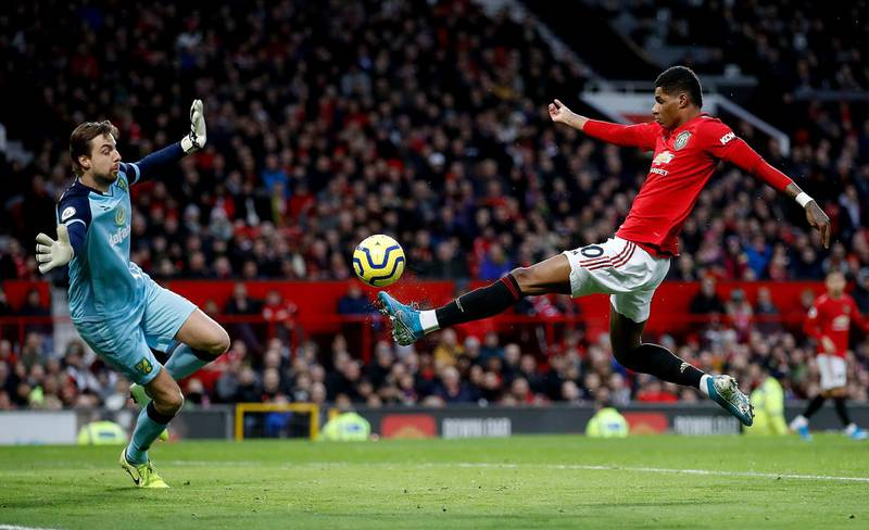 """Manchester United's Marcus Rashford scores his side's first goal of the game during the Premier League match at Old Trafford, Manchester. PA Photo. Picture date: Saturday January 11, 2020. See PA story SOCCER Man Utd. Photo credit should read: Martin Rickett/PA Wire. RESTRICTIONS: EDITORIAL USE ONLY No use with unauthorised audio, video, data, fixture lists, club/league logos or """"live"""" services. Online in-match use limited to 120 images, no video emulation. No use in betting, games or single club/league/player publications."""