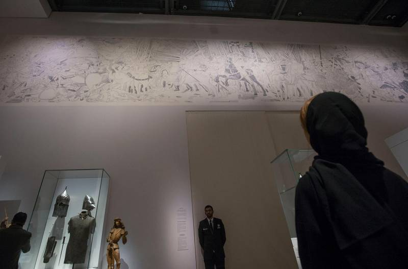 Abu Dhabi, United Arab Emirates- Artwork reflected at the wall at Furusiyya The Art of Chivalry between East and West, which draws links between knightly traditions of Europe and the Middle East at Louvre Abu Dhabi.  Leslie Pableo for The National