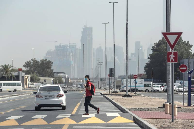 DUBAI, UNITED ARAB EMIRATES. 01 APRIL 2020. A man walks, while wearing a mask, to get to work during the ongoing Stay At Home policy being enforced on a National level in the UAE. With generally mild weather and the general slow down in the use of public transport many commuters are opting to walk distances they would previously have used motorised transport for. (Photo: Antonie Robertson/The National) Journalist: Standalone. Section: National..