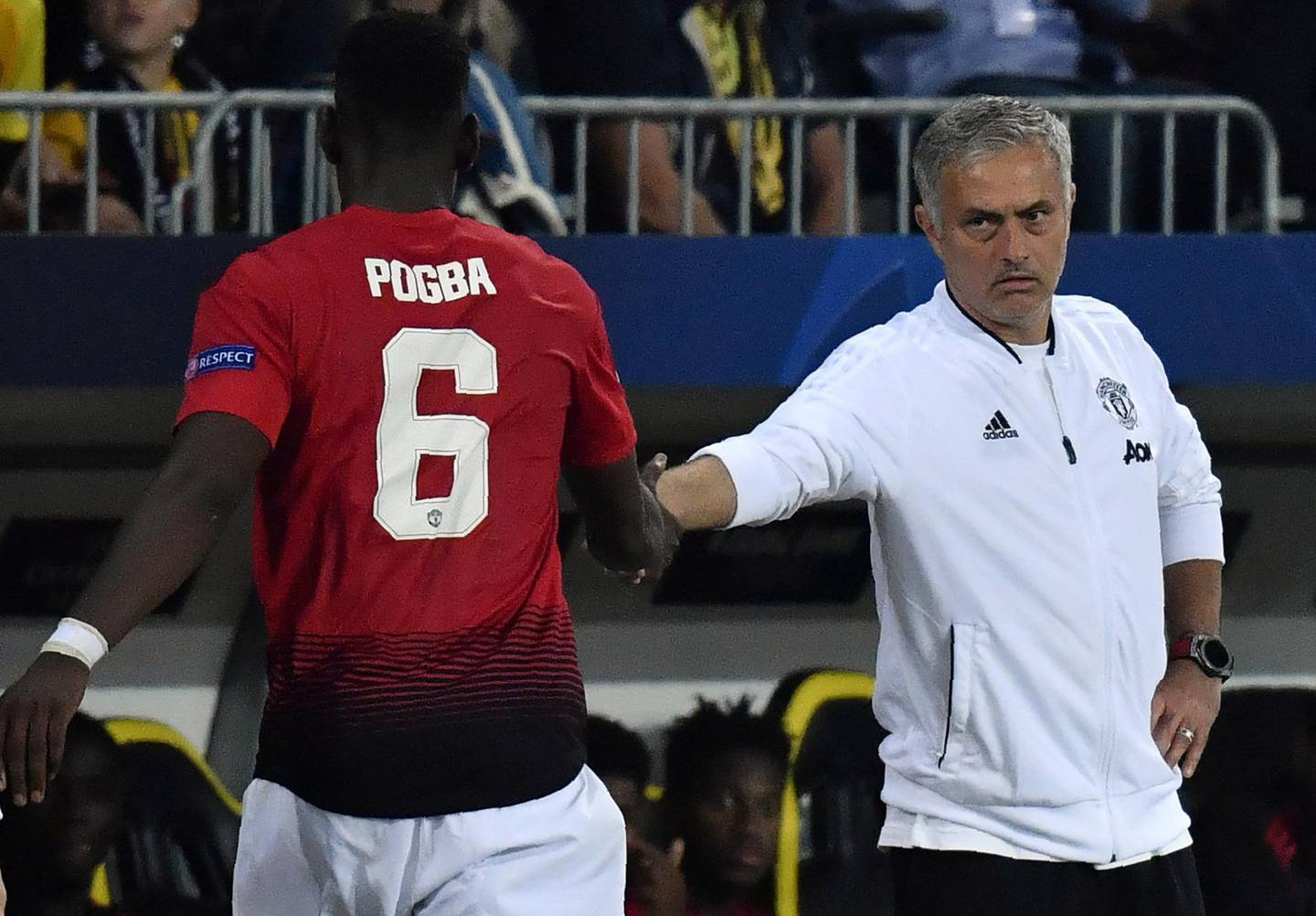 Manchester United's French midfielder Paul Pogba (L) shakes hands with Manchester United's Portuguese manager Jose Mourinho after his substitution during the UEFA Champions League group H football match between Young Boys and Manchester United at The Stade de Suisse in Bern on September 19, 2018. (Photo by Alain GROSCLAUDE / AFP)