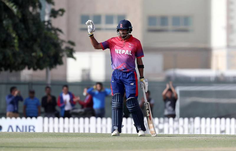 DUBAI , UNITED ARAB EMIRATES , January 28 – 2019 :- Paras Khadka of Nepal celebrating after scoring his century during the one day international cricket match between UAE vs Nepal held at ICC cricket academy in Dubai. Nepal won the match by 4 wickets. Paras scored 115 runs in this match. ( Pawan Singh / The National ) For Sports. Story by Paul