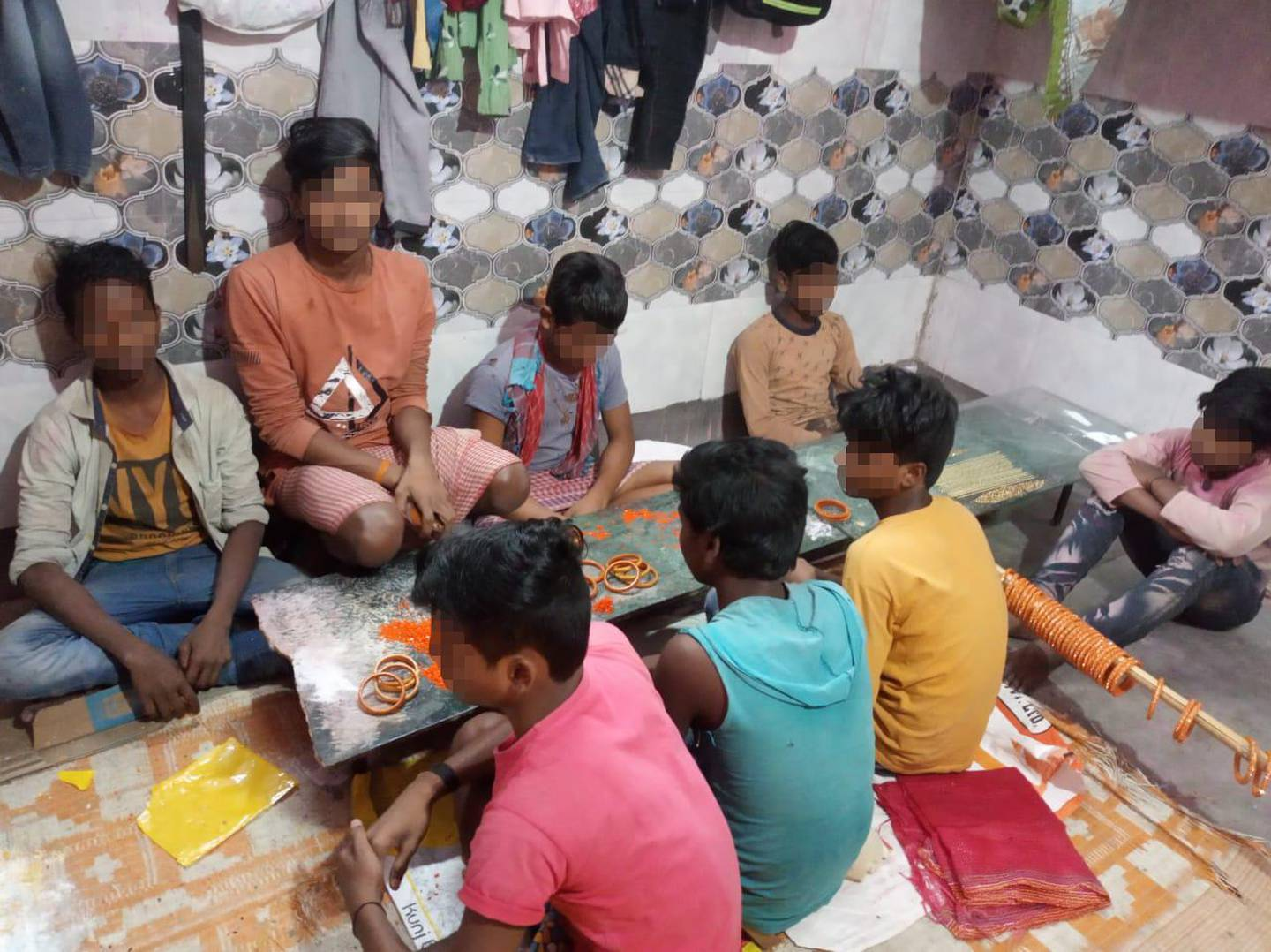 An NGO and a team of Indian police rescued 45 children, some as young as seven years old, from a bangle workshop in New Delhi. The children were kept in absymal conditions and forced to work for 12 hours a day. The children were forced to squat for 12 hours on floor and painfully glued sparkles in bangles. The children are now taken into children's shelter at the NGO and will be rehabilitated.. Photo by Prayaas Childline