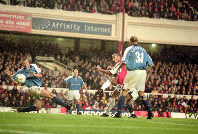28 Oct 2000:  Thierry Henry scores Arsenal's fourth goal during the FA Carling Premier League match against Manchester City played at Highbury in London. Arsenal won the game 5-0. \ Mandatory Credit: Shaun Botterill /Allsport