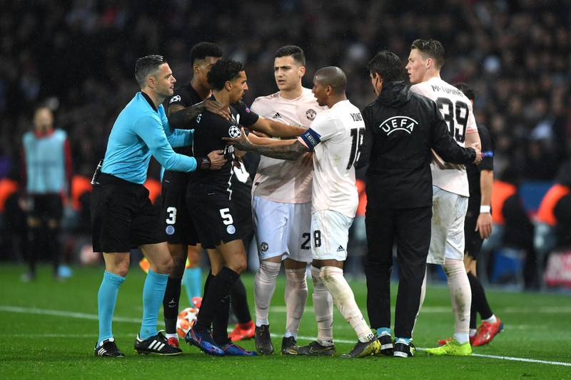PARIS, FRANCE - MARCH 06: Marquinhos of PSG and Ashley Young of Manchester United clash  during the UEFA Champions League Round of 16 Second Leg match between Paris Saint-Germain and Manchester United at Parc des Princes on March 06, 2019 in Paris, . (Photo by Shaun Botterill/Getty Images)