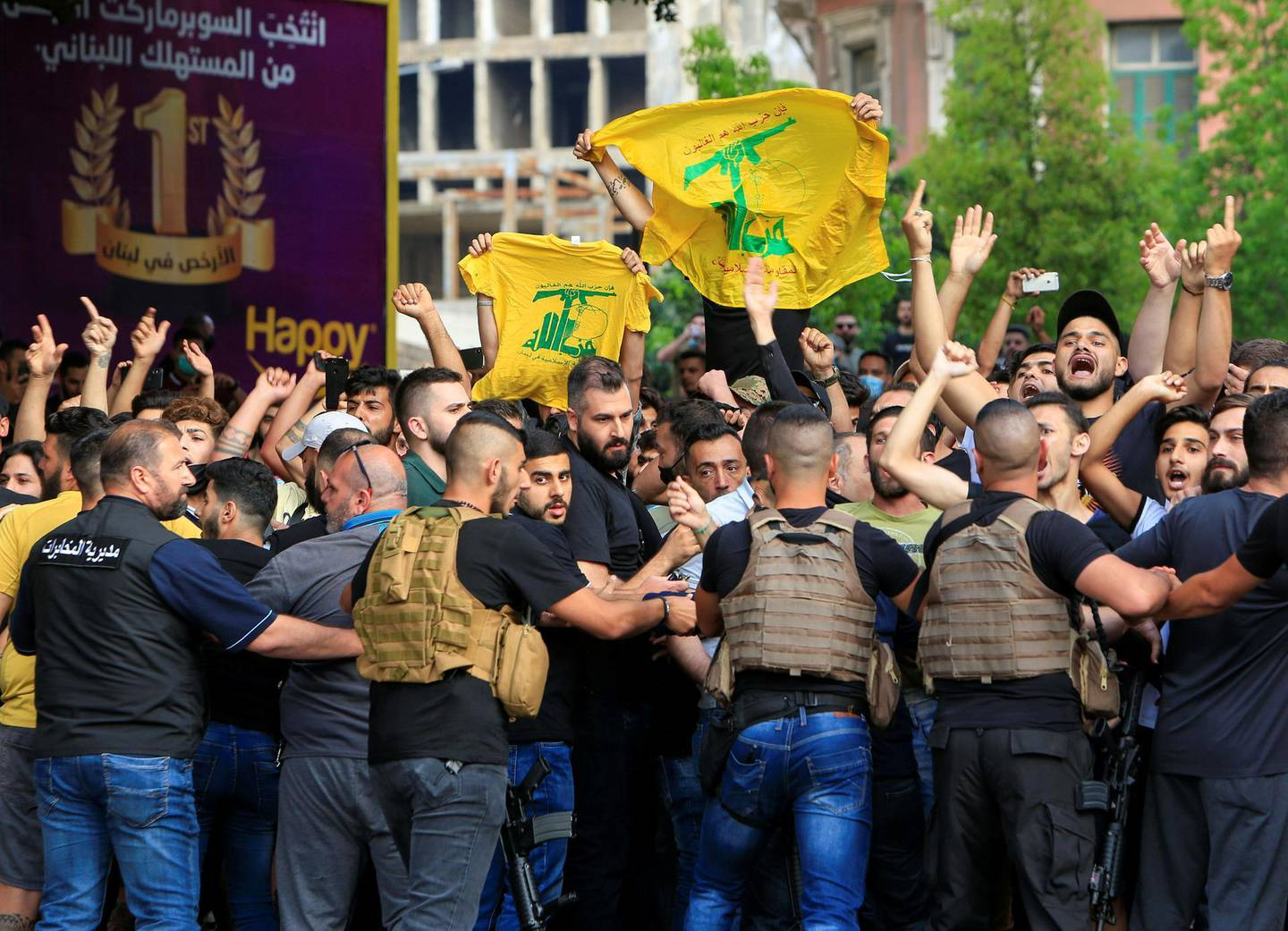 SENSITIVE MATERIAL. THIS IMAGE MAY OFFEND OR DISTURB    Lebanese army try to block supporters of the Lebanese Shi'ite groups Hezbollah and Amal as they gesture and chant slogans against anti-government demonstrators, in Beirut, Lebanon June 6, 2020. REUTERS/Ali Hashisho