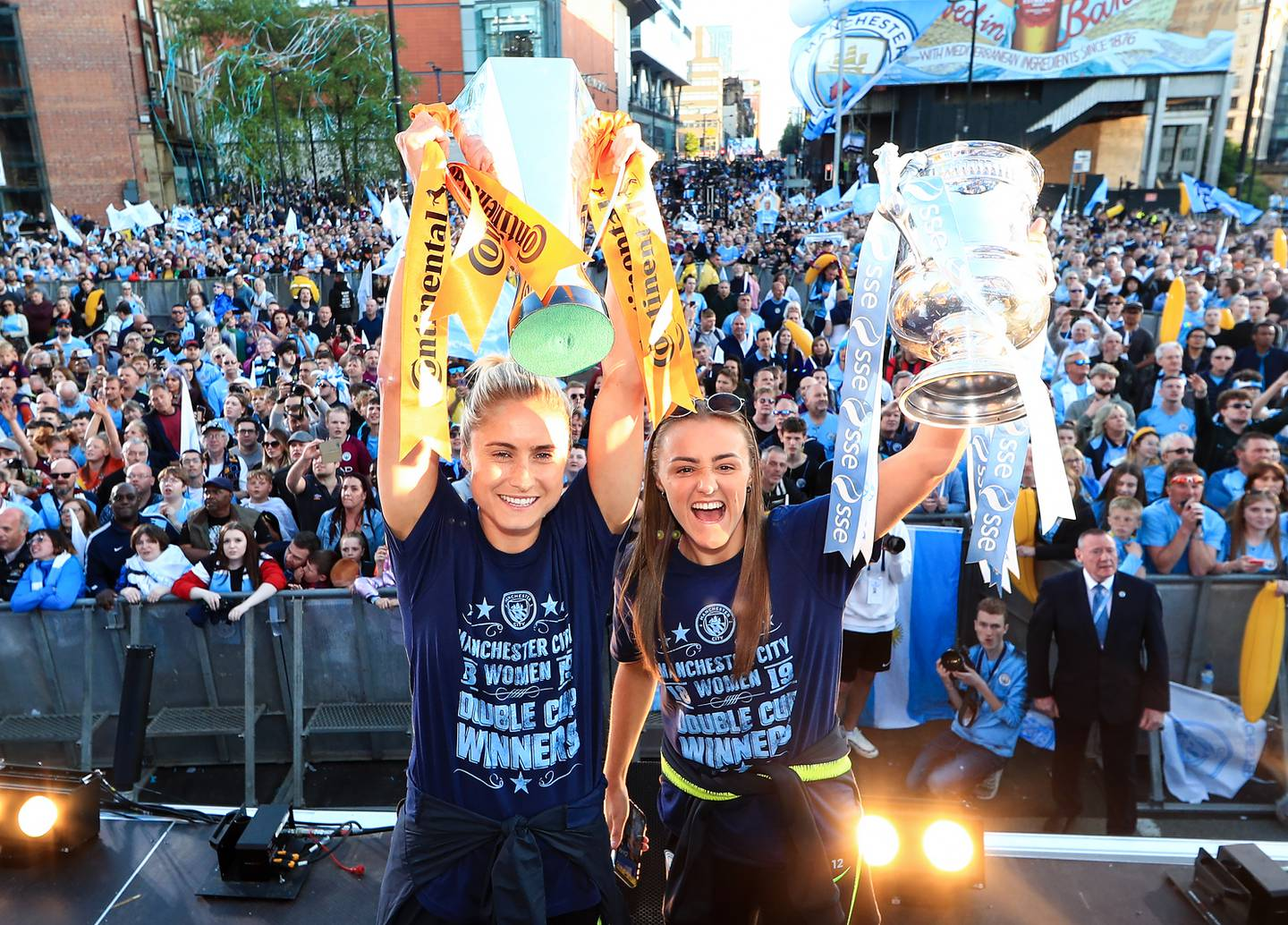 MANCHESTER, ENGLAND - MAY 20: Steph Houghton and Georgia Stanway of Manchester City celebrate with the Women's FA Cup and Continental Cup trophies during the Manchester City Teams Celebration Parade on  on May 20, 2019 in Manchester, England. (Photo by Matt McNulty - Manchester City/Manchester City FC via Getty Images)