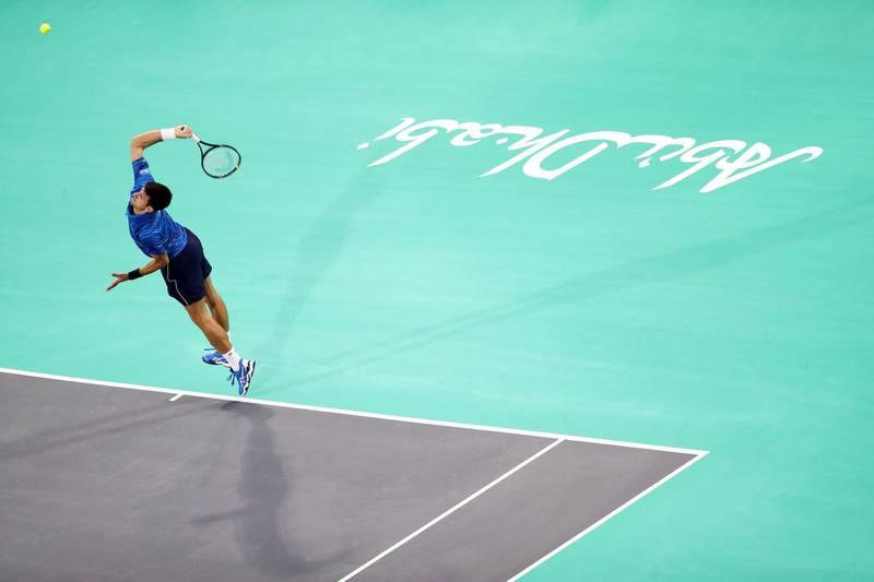 Abu Dhabi, United Arab Emirates - Reporter: Jon Turner: Novak Djokovic serves during the third place play-off between Novak Djokovic v Karen Khachanov at the Mubadala World Tennis Championship. Saturday, December 21st, 2019. Zayed Sports City, Abu Dhabi. Chris Whiteoak / The National