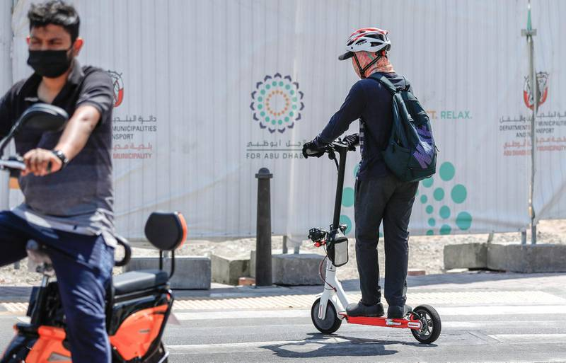 Abu Dhabi, United Arab Emirates, September 18, 2020.  E-scooter riders along Al Falah Street in central Abu Dhabi on a Friday afternoon.Victor Besa /The NationalSection:  NA/Standalone