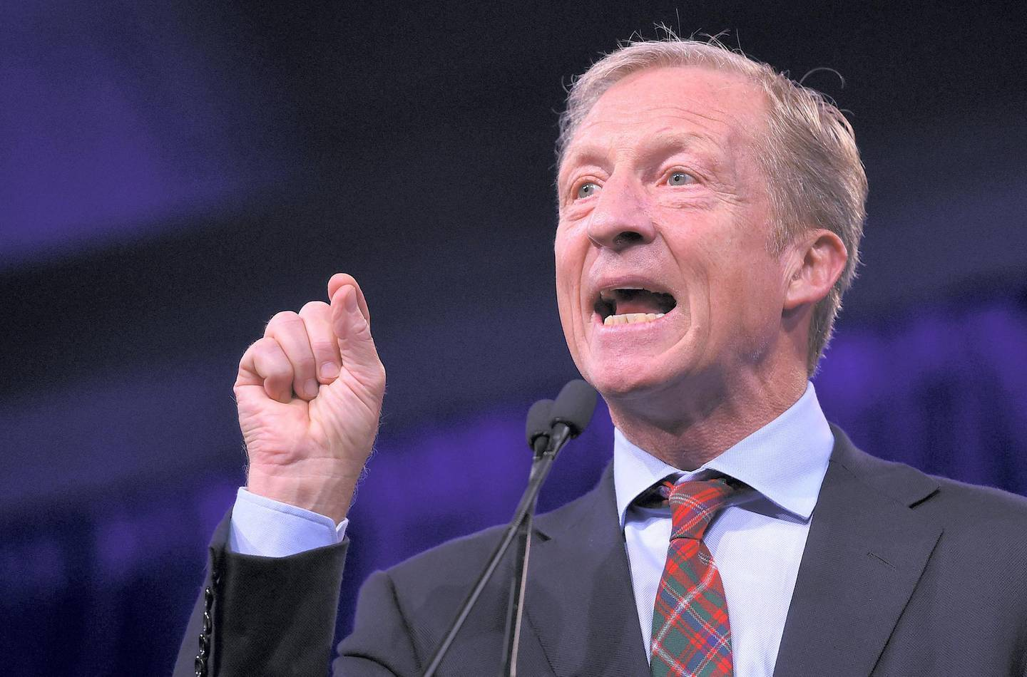 2020 US Democratic Presidential hopeful US billionaire philanthropist Tom Steyer speaks on-stage during the Democratic National Committee's summer meeting in San Francisco, California on August 23, 2019. (Photo by JOSH EDELSON / AFP)