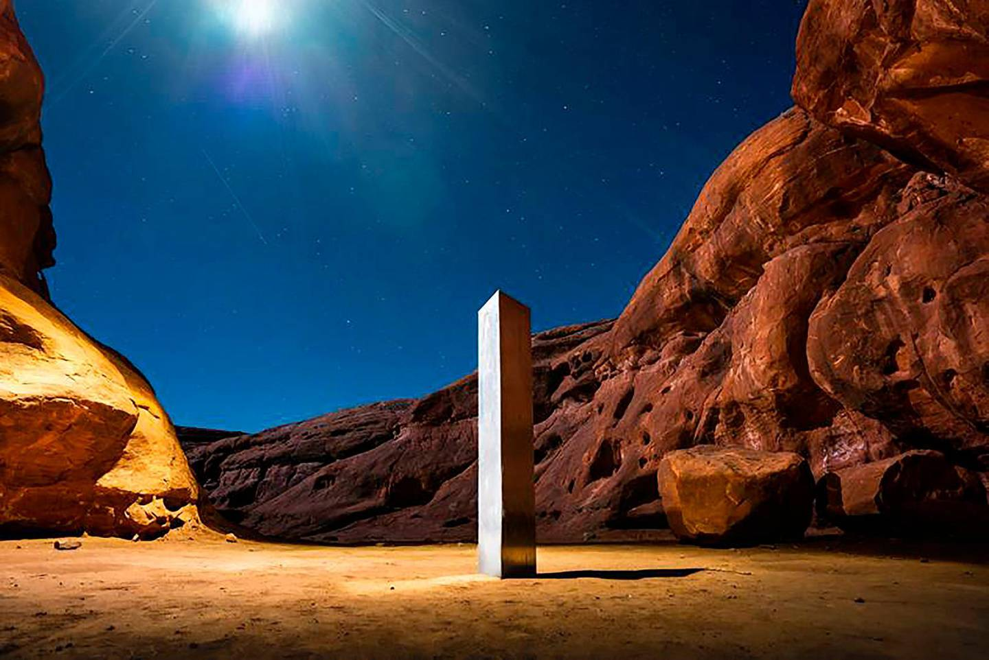 AThis Nov. 27, 2020 photo by Terrance Siemon shows a monolith that was placed in a red-rock desert in an undisclosed location in San Juan County southeastern Utah. New clues have surfaced in the disappearance of the gleaming monolith in Utah that seemed to melt away as mysteriously as it appeared in the red-rock desert. A Colorado photographer told a TV station in Salt Lake City that he saw four men push over the hollow, stainless steel structure in Utah on Friday night. (Terrance Siemon via AP)