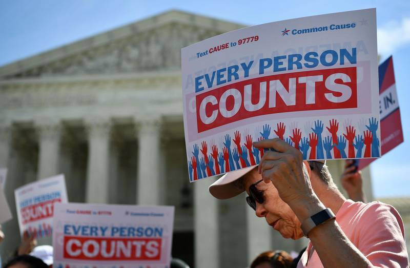 (FILES) In this file photo demonstrators rally at the US Supreme Court in Washington, DC, on April 23, 2019, to protest a proposal to add a citizenship question in the 2020 Census. US President Donald Trump's administration wages its last major policy fight before the Supreme Court on November 30, 2020 as it seeks to exclude undocumented immigrants from the population count used to determine states' representation in Congress. If the outgoing president's plan goes forward, states with large numbers of undocumented immigrants could see their influence reduced in the US House of Representatives.  / AFP / MANDEL NGAN