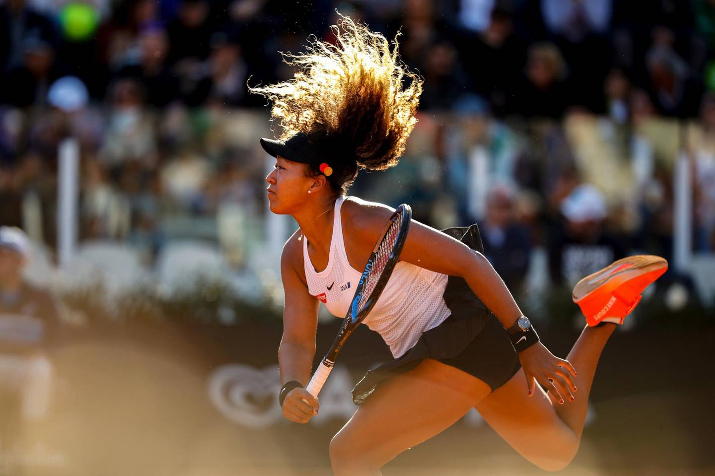 ROME, ITALY - MAY 16: Naomi Osaka of Japan serves against Mihaela Buzarnescu of Romania in their Women's Singles Round of 16 match during Day Five of the International BNL d'Italia at Foro Italico on May 16, 2019 in Rome, Italy. (Photo by Adam Pretty/Getty Images) ***BESTPIX***