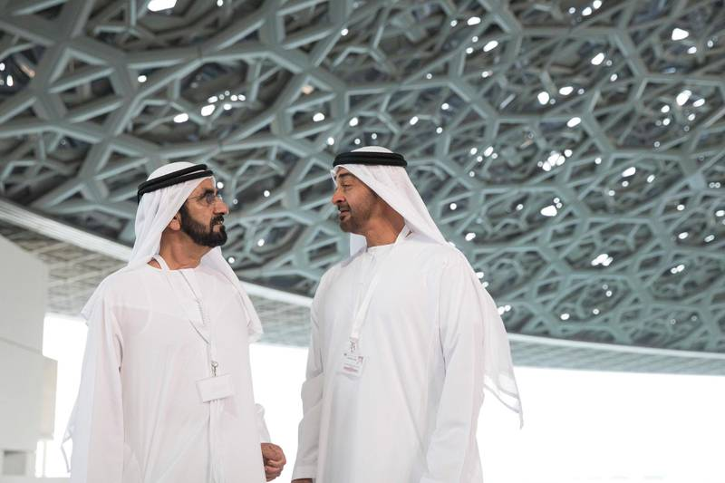 SAADIYAT ISLAND, ABU DHABI, UNITED ARAB EMIRATES - September 11, 2017: HH Sheikh Mohamed bin Zayed Al Nahyan, Crown Prince of Abu Dhabi and Deputy Supreme Commander of the UAE Armed Forces (R), and HH Sheikh Mohamed bin Rashid Al Maktoum, Vice-President, Prime Minister of the UAE, Ruler of Dubai and Minister of Defence (L), stand for a photograph while touring the newly constructed Louvre Abu Dhabi.  ( Ryan Carter / Crown Prince Court - Abu Dhabi ) ---
