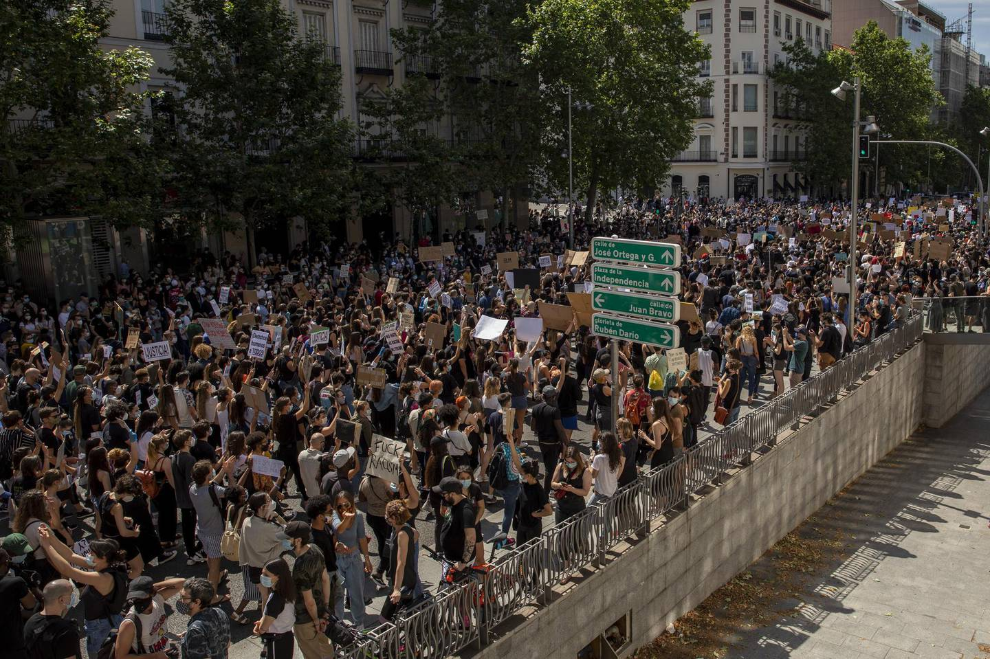 MADRID, SPAIN - JUNE 07: A general view as demonstrators hold placards during a Black Lives Matter protest following the death of George Floyd outside the United States Embassy on June 07, 2020 in Madrid, Spain.The death of an African-American man, George Floyd, while in the custody of Minneapolis police has sparked protests across the United States, as well as demonstrations of solidarity in many countries around the world. (Photo by Pablo Blazquez Dominguez/Getty Images)