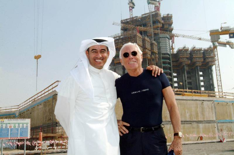 DUBAI, UNITED ARAB EMIRATES  - DECEMBER 6:  Emaar Properties' iconic Burj Dubai development received its most high profile visitor to date when celebrated Italian fashion designer Giorgio Armani was given a personal tour by Emaar's Chairman Mohamed Ali Alabbar on Sunday, December 4. The Burj Dubai, which is anticipated to be the tallest tower in the world when completed in 2008, will feature one of the world's first Armani Hotels.  (Photo by Business Wire via Getty Images)