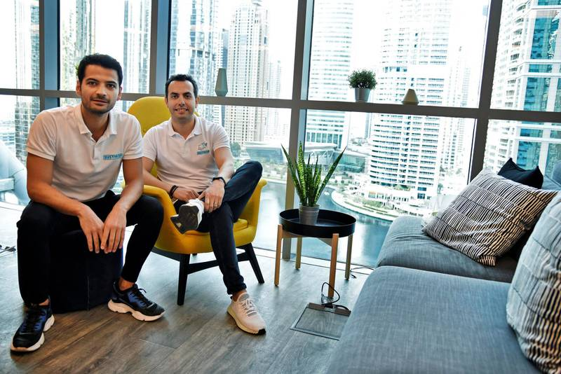Kerem Kuyucu, left, and AliCagatay Ozcan, founders of Justmop pose for photos inside their office at Jumeirah Lake Towers, Dubai, UAE, Wednesday, Feb. 12, 2020. The two have now transformed their marketplace into a super app and expanded into 4 GCC countries. Photos by Shruti Jain The National