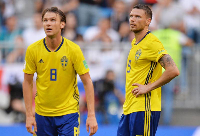 epa06871478 Albin Ekdal (L) and Marcus Berg of Sweden react after going 2-0 down during the FIFA World Cup 2018 quarter final soccer match between Sweden and England in Samara, Russia, 07 July 2018.  (RESTRICTIONS APPLY: Editorial Use Only, not used in association with any commercial entity - Images must not be used in any form of alert service or push service of any kind including via mobile alert services, downloads to mobile devices or MMS messaging - Images must appear as still images and must not emulate match action video footage - No alteration is made to, and no text or image is superimposed over, any published image which: (a) intentionally obscures or removes a sponsor identification image; or (b) adds or overlays the commercial identification of any third party which is not officially associated with the FIFA World Cup)  EPA/PETER POWELL   EDITORIAL USE ONLY