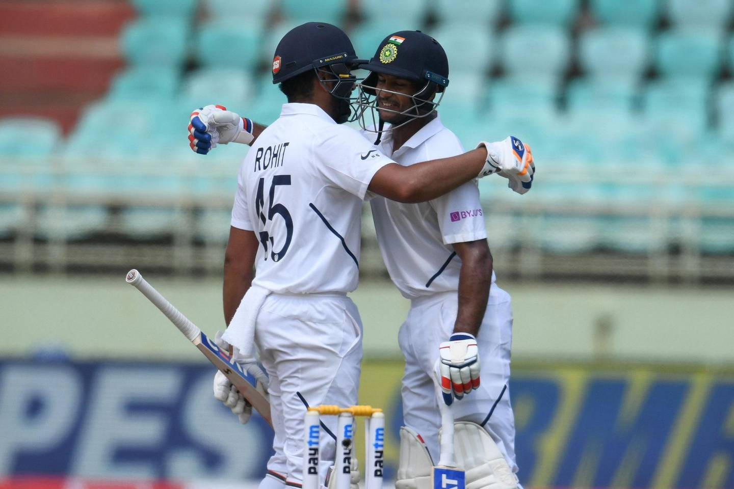 Indian cricketer Mayank Agarwal (R) and Rohit Sharma (L) greet each other during the first day's play of the first Test match between India and South Africa at the Dr. Y.S. Rajasekhara Reddy ACA-VDCA Cricket Stadium in Visakhapatnam on October 2, 2019. ----IMAGE RESTRICTED TO EDITORIAL USE - STRICTLY NO COMMERCIAL USE----- / GETTYOUT  / AFP / NOAH SEELAM / ----IMAGE RESTRICTED TO EDITORIAL USE - STRICTLY NO COMMERCIAL USE----- / GETTYOUT