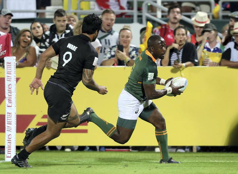 Dubai, United Arab Emirates - December 07, 2019: Siviwe Soyizwapi of South Africa scores during the game between New Zealand and South Africa in the mens final at the HSBC rugby sevens series 2020. Saturday, December 7th, 2019. The Sevens, Dubai. Chris Whiteoak / The National