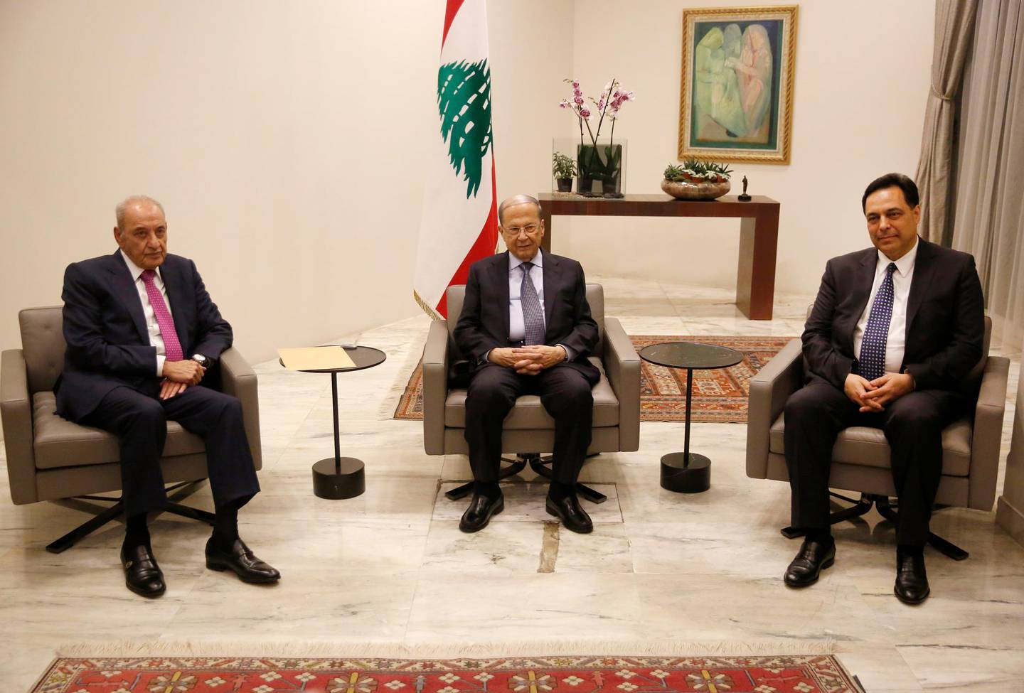 Lebanese President Michel Aoun, center, meets with Lebanese newly-assigned Prime Minister, Hassan Diab, right, and Parliament Speaker Nabih Berri, left, at the presidential palace, in Baabda, east of Beirut, Lebanon, Thursday, Dec. 19, 2019.  Aoun named Diab as prime minister after a day of consultations with lawmakers in which he gained a simple majority of the 128-member parliament. Sixty-nine lawmakers, including the parliamentary bloc of the Shiite Hezbollah and Amal movements as well as lawmakers affiliated with President Michel Aoun gave him their votes. (AP Photo/Hussein Malla)