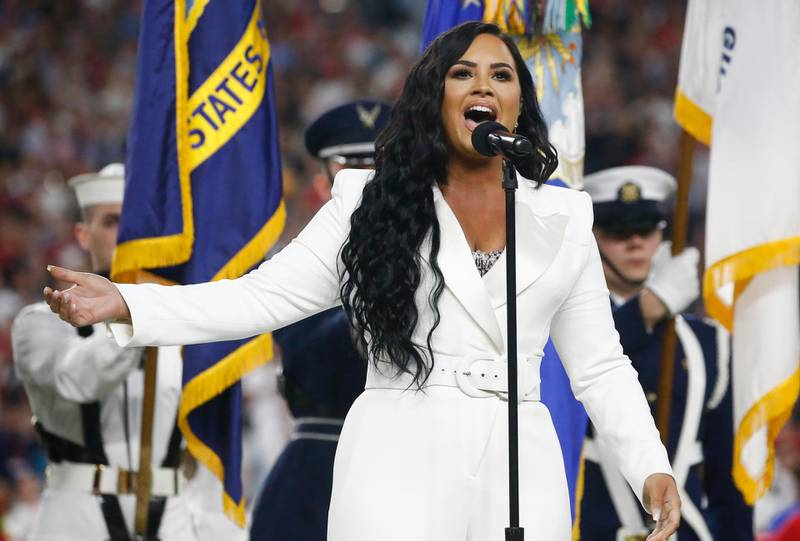 epa08189243 US singer Demi Lovato performs the National Anthem before the AFC Champion Kansas City Chiefs play the NFC Champion San Francisco 49ers in the National Football League's Super Bowl LIV at Hard Rock Stadium in Miami Gardens, Florida, USA, 02 February 2020.  EPA-EFE/LARRY W. SMITH