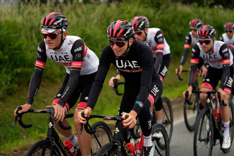Slovenia's Tadej Pogacar center, rides with teammates during a training, outside Brest, western France, Thursday, June 24, 2021, ahead of Saturday's start of the Tour de France cycling race. (AP Photo/Daniel Cole)