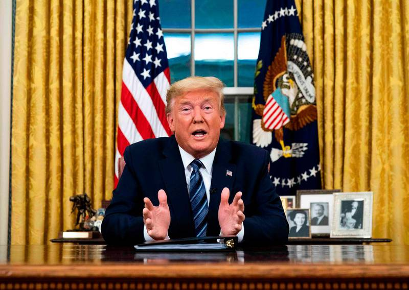 """US President Donald Trump addresses the Nation from the Oval Office about the widening novel coronavirus (Covid-19) crisis in Washington, DC on March 11, 2020. President Donald Trump announced on March 11, 2020 the United States would ban all travel from Europe for 30 days starting to stop the spread of the coronavirus outbreak. """"To keep new cases from entering our shores, we will be suspending all travel from Europe to the United States for the next 30 days. The new rules will go into effect Friday at midnight,"""" Trump said in an address to the nation.  / AFP / POOL / Doug Mills"""