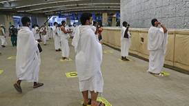 Hajj pilgrims perform the stoning ritual at Jamrat Al Aqabah