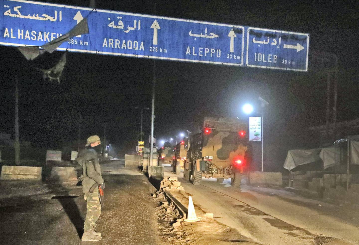 A picture taken before daybreak on March 1, 2019 shows Turkish military vehicles heading towards the Syrian southern countryside of the rebel-held Idlib province from Bab al-Hawa border crossing with Turkey. (Photo by Aaref WATAD / AFP)