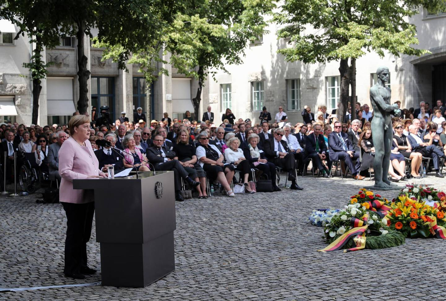epa07729224 German Chancellor Angela Merkel speaks during a commemoration service for the 75th anniversary of the attempted assassination of Adolf Hitler by the German anti-Nazi resistance, at the Bendlerblock in Berlin, Germany, 20 July 2019. The anniversary commemorates the members of the resistance, led by Claus von Stauffenberg, who were arrested and executed after a failed assassination attempt on Adolf Hitler that took place on 20 July 1944. Von Stauffenberg was executed in the Bendlerblock courtyard.  EPA/FELIPE TRUEBA