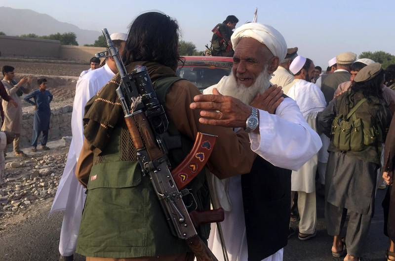 Taliban fighters gather with the residences in Surkhroad district of Nangarhar province, east of Kabul, Afghanistan, Saturday, June 16, 2018. A suicide bomber blew himself up in eastern Afghanistan on Saturday as mostly Taliban fighters gathered to celebrate a three-day cease fire marking the Islamic holiday of Eid al-Fitr, killing 21 people and wounding another 41, said the Nangarhar provincial Police Chief Ghulam Sanayee Stanikzai. Most of the dead and wounded were believed to be Taliban, he said. (AP Photo/Rahmat Gal)