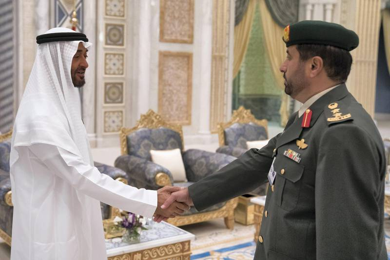 ABU DHABI, UNITED ARAB EMIRATES - May 20, 2018: HH Sheikh Mohamed bin Zayed Al Nahyan Crown Prince of Abu Dhabi Deputy Supreme Commander of the UAE Armed Forces (L), receives a member of the UAE Armed Forces, during an iftar reception at the Presidential Palace.   ( Hamad Al Kaabi / Crown Prince Court - Abu Dhabi ) ---