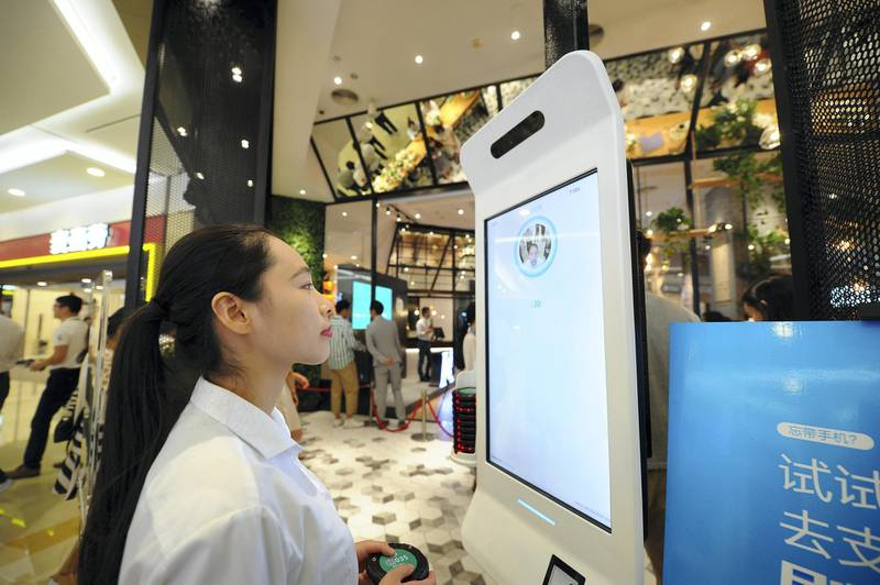 HANGZHOU, CHINA - SEPTEMBER 01:  A customer purchases goods via Alipay which could collect money through recognizing customers' identity at KFC's KPRO restaurant on September 1, 2017 in Hangzhou, Zhejiang Province of China. Alipay uses face recognition system to collect money when customers take commodities to pass through a payment gateway.  (Photo by VCG/VCG via Getty Images)