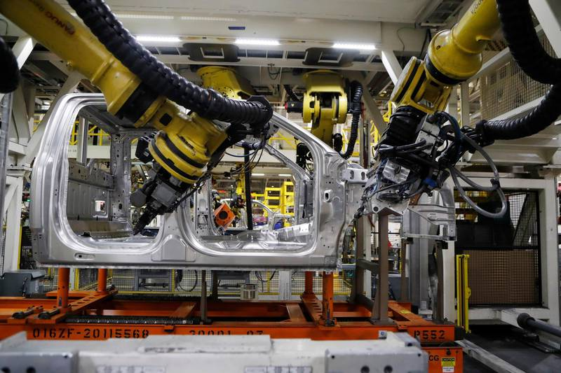 FILE- In this Sept. 27, 2018, file photo robots weld the cab of a 2018 Ford F-150 truck on the assembly line at the Ford Rouge assembly plant in Dearborn, Mich. On Thursday, Nov. 1, the Institute for Supply Management, a trade group of purchasing managers, issues its index of manufacturing activity for October. (AP Photo/Carlos Osorio, File)