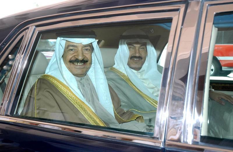 Kuwaiti Prime Minister Sheikh Nasser al-Mohammad Al-Ahmad Al-Sabah (R) leaves Kuwait international airport after welcoming his Bahraini counterpart Sheikh Khalifa bin Salman Al-Khalifa (L) 15 April 2007 in Kuwait City. Al-Khalifa in Kuwait for two-day official visit.  AFP PHOTO/YASSER AL-ZAYYAT (Photo by YASSER AL-ZAYYAT / AFP)