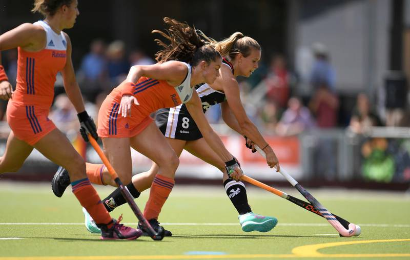 Germany's Anne Schroeder, right, and Dutch Lidewig Welten challenge for the ball during a women's hockey match between Germany and the Netherlands in Gruenwald, southern Germany, Saturday, July 14, 2018. (Andreas Gebert/dpa via AP)
