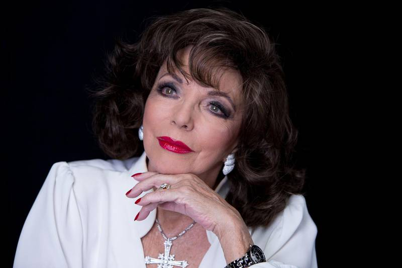 Actress Joan Collins poses for a portrait on Tuesday, Dec. 8, 2015, in New York.  Some of Collins' personal and professional clothing, jewelry and correspondence including love letters from Warren Beatty will be auctioned on Dec. 16 at Julien's Auctions in Beverly Hills, Calif. (Photo by Amy Sussman/Invision/AP)