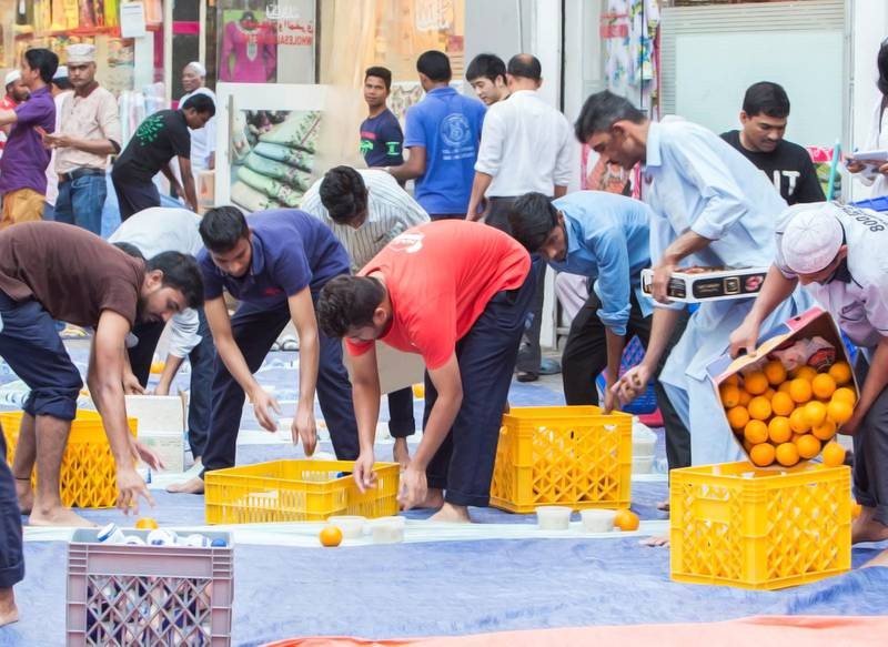 DUBAI,  UNITED ARAB EMIRATES, 20 May 2018 - Muslims are preparing the area around the mosque for the iftar at Lootah Masjid Mosque, Deira, Dubai. Leslie Pableo for The National  for Ramola Talwar story