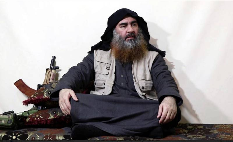 This image made from video posted on a militant website on Monday, April 29, 2019, purports to show the leader of the Islamic State group, Abu Bakr al-Baghdadi, being interviewed by his group's Al-Furqan media outlet. Al-Bagdadi acknowledged in his first video since June 2014 that IS lost the war in the eastern Syrian village of Baghouz that was captured last month by the Kurdish-led Syrian Democratic Forces. (Al-Furqan media via AP)
