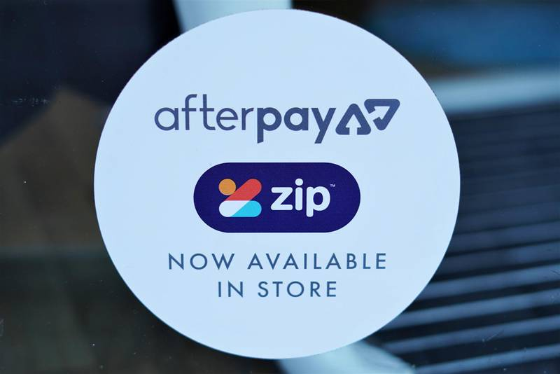 A logo for the companies Afterpay and Zip is seen in a store window in Sydney, Australia, July 9, 2020.  REUTERS/Stephen Coates