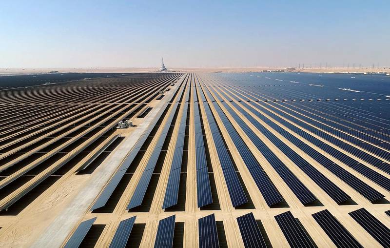 This screenshot from undated footage released by Strategy & Government Communications of Dubai, shows the Mohammed bin Rashid Al Maktoum Solar Park, about 50 kilometres south of Dubai, United Arab Emirates. In the oil-rich UAE, an unusual sight is rising in Dubai -- a coal-fired power plant, a first for the region. The $3.4 billion Hassyan power plant in Dubai appears puzzling as the UAE hosts the headquarters of the International Renewable Energy Agency. (Strategy & Government Communications of Dubai via AP)